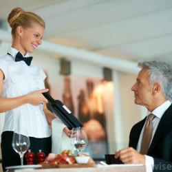 waitress-serving-a-bottle-of-wine
